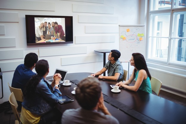 business-executives-doing-video-conference_1170-1922